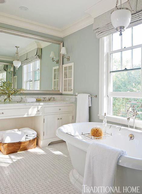 I love the elegant simplicity of this bath which fills the space with peace and luxury.
